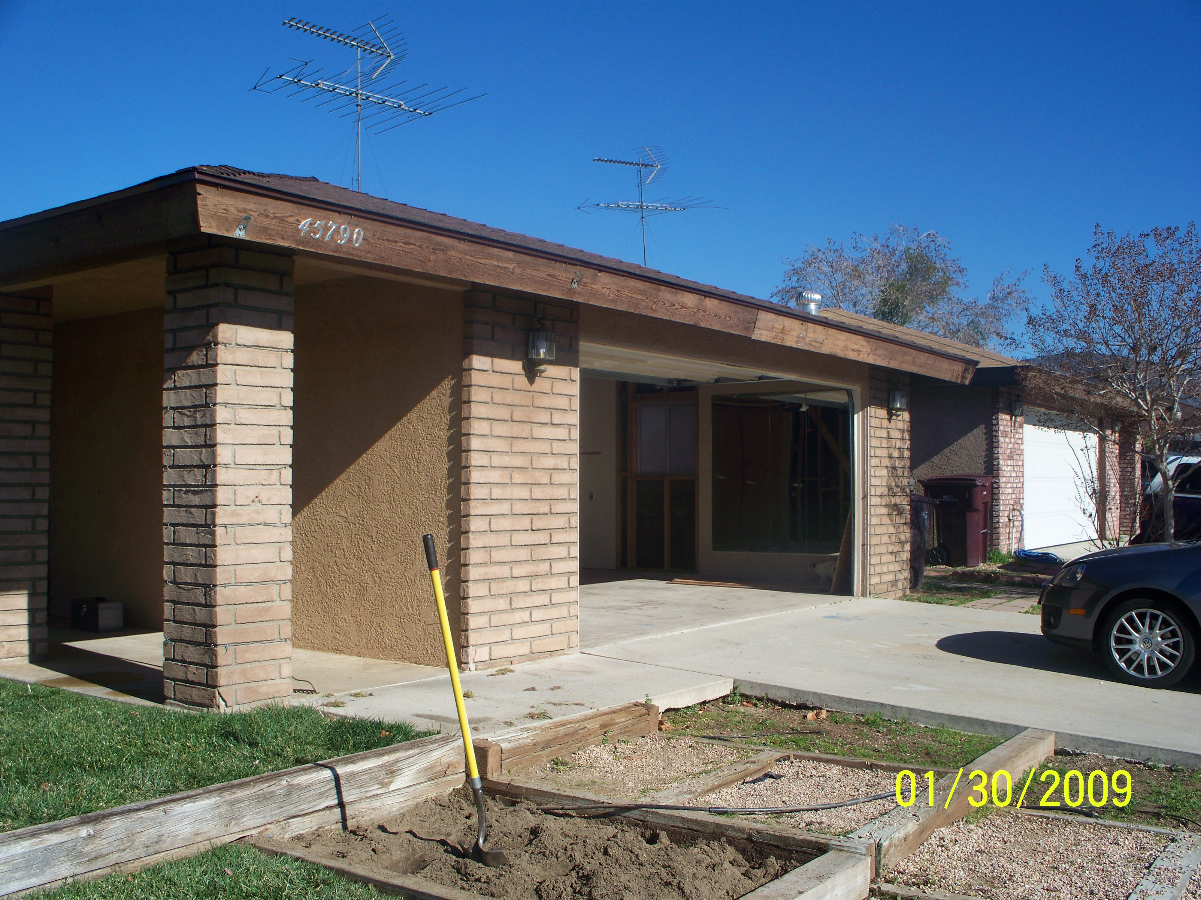 BEFORE - CUSTOMER REQUESTED REMOVAL OF BRICKS, REPAIR AND MATCH EXISTING FINISH.